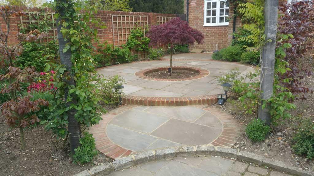 circular patio in summer garden