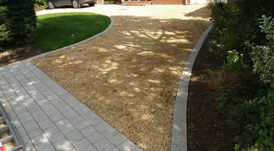 sweeping driveway in urban front garden