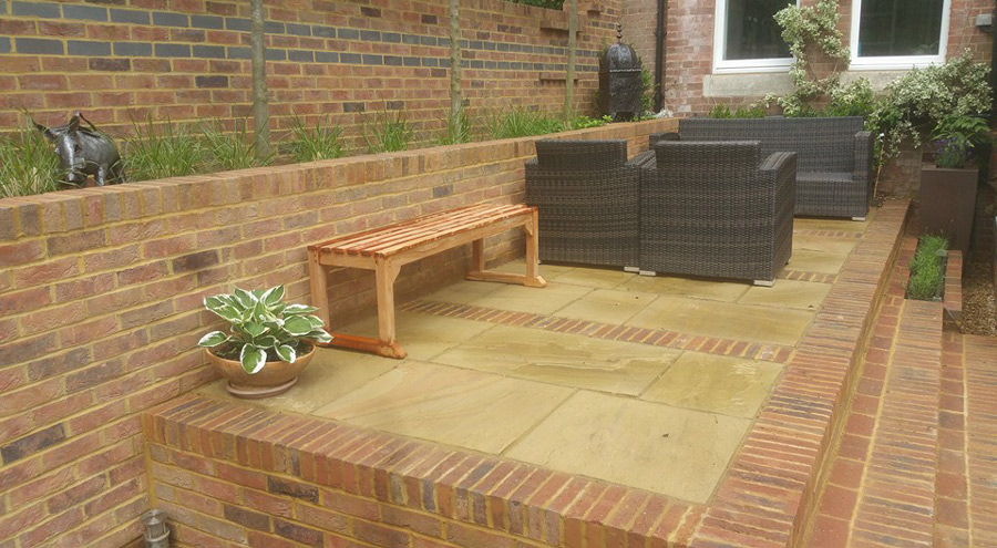 raised patio with brick highlights