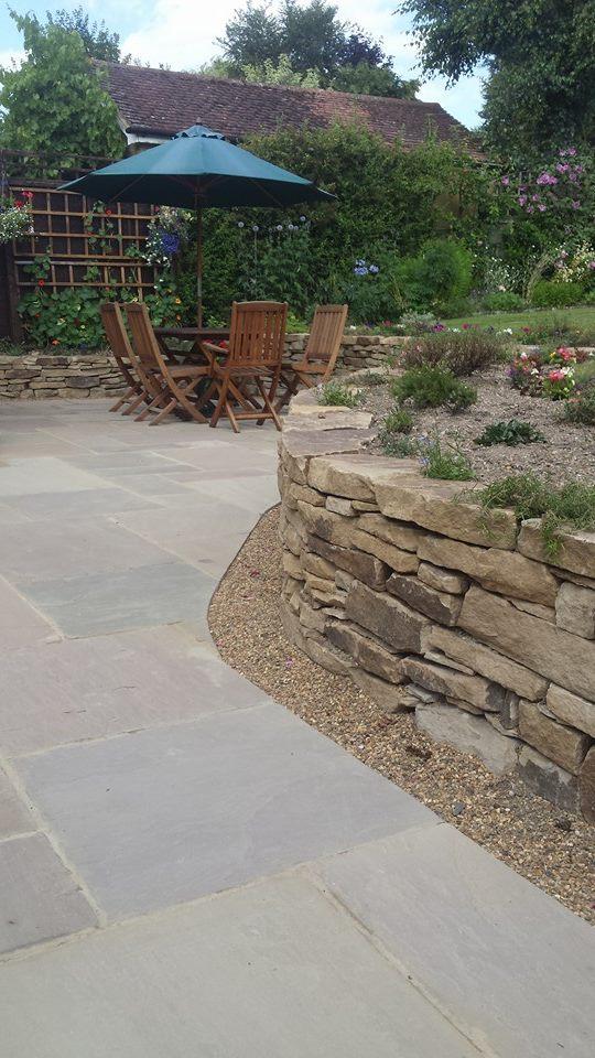 stone retaining wall with beautiful patio