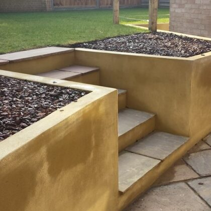 retaining wall with steps to a lawn