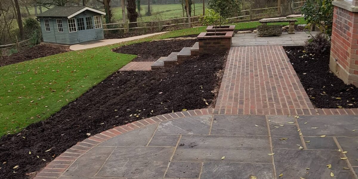 garden path leading from patio to a summerhouse