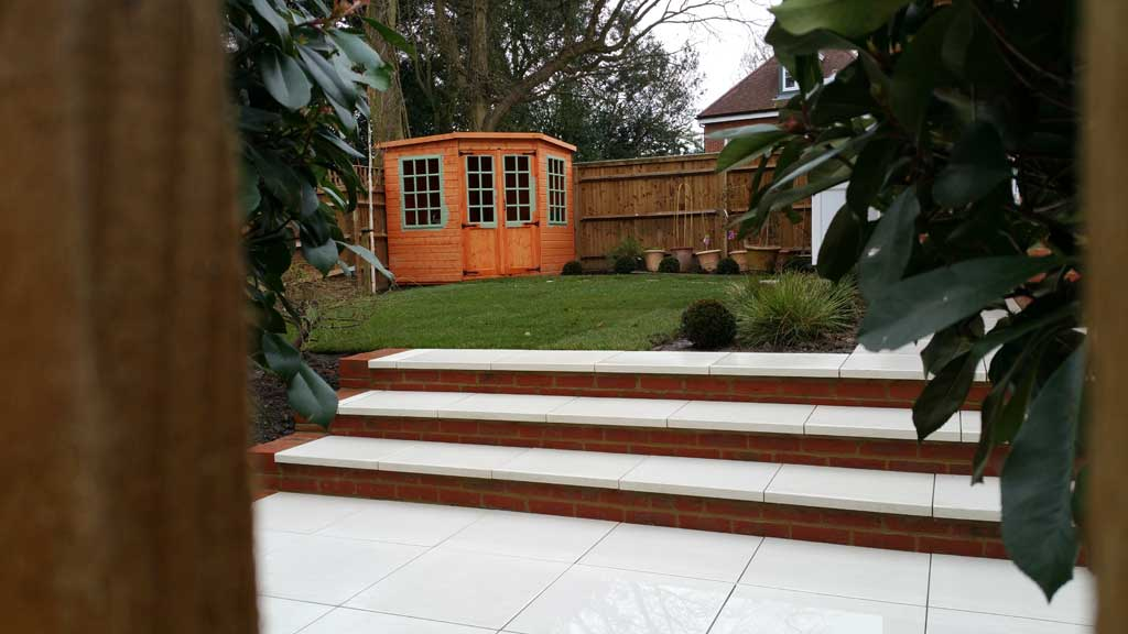 Back garden makeover with patio and summerhouse