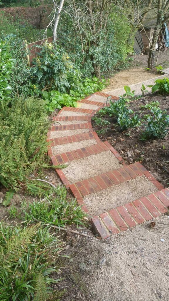 sloping garden with informal steps leading down
