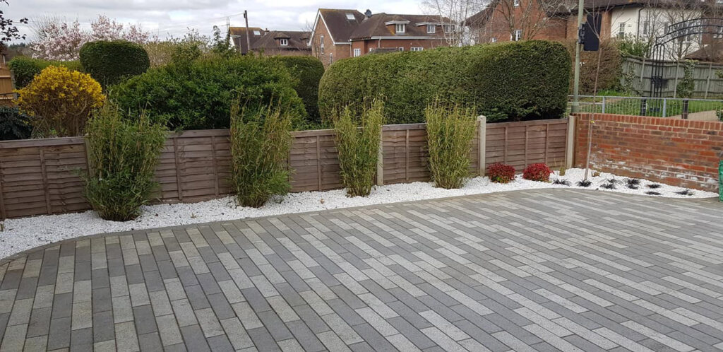 modern driveway with brick pavers and low maintenance planting