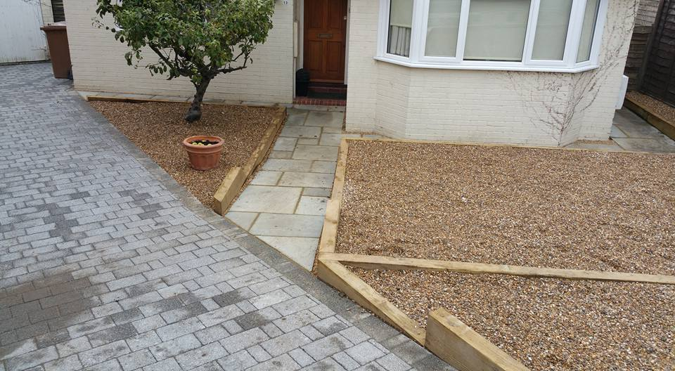 front garden with sloping paths and easy care gravel borders